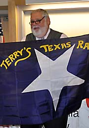 man holding a Civil War flag